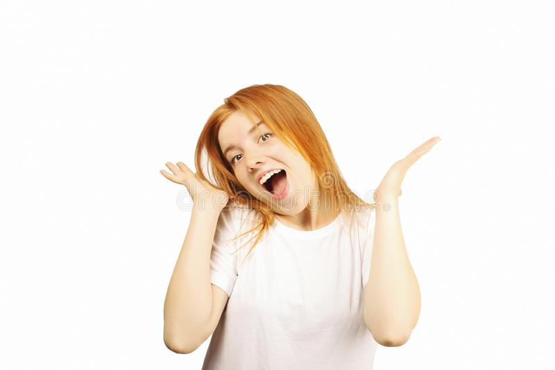 Young beautiful woman, attractive natural redhead, showing emotions, facial expressions, posing on isolated background. stock photos