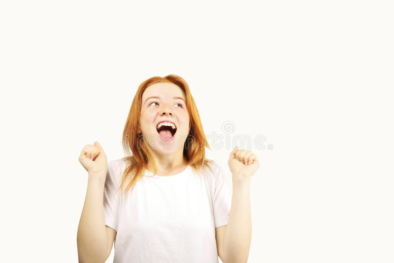 Young beautiful woman, attractive natural redhead, showing emotions, facial expressions, posing on isolated background. stock photo