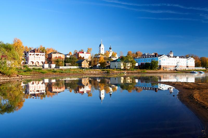 Beautiful reflection of the city in the water of Volga river. Beautiful reflection myshkin city water russia volga river town travel view landmark castle old stock photos