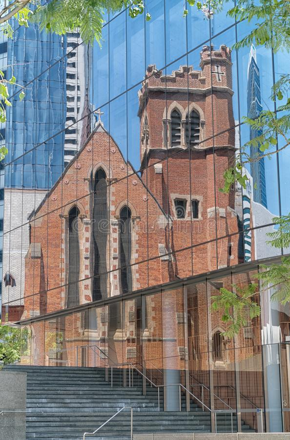St. Georges Cathedral, Perth, Australia. Beautiful reflection of old St. Georges Cathedral in the front of a modern office building, Perth, Western Australia royalty free stock photo