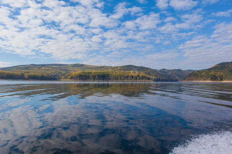 Beautiful reflection of the siberian nature in Yenisei river. Reflection of mountains in Siberia yenisei river. Russia stock images