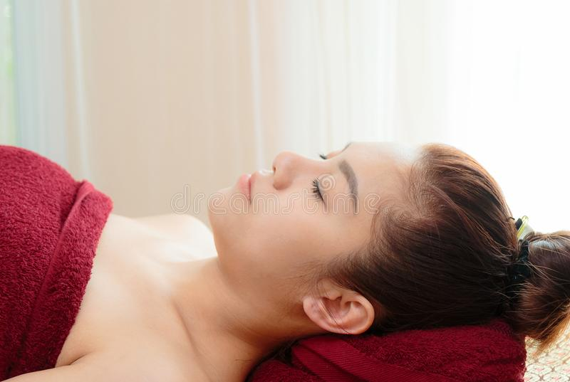 relaxing woman getting spa massage royalty free stock photo
