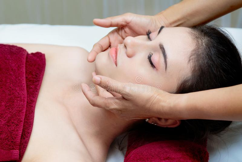 Relaxing woman getting spa massage stock image
