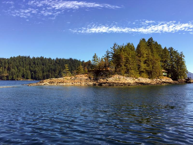 The beautiful remote small Alexander island, in West Bay, off of Gambier Island royalty free stock photography