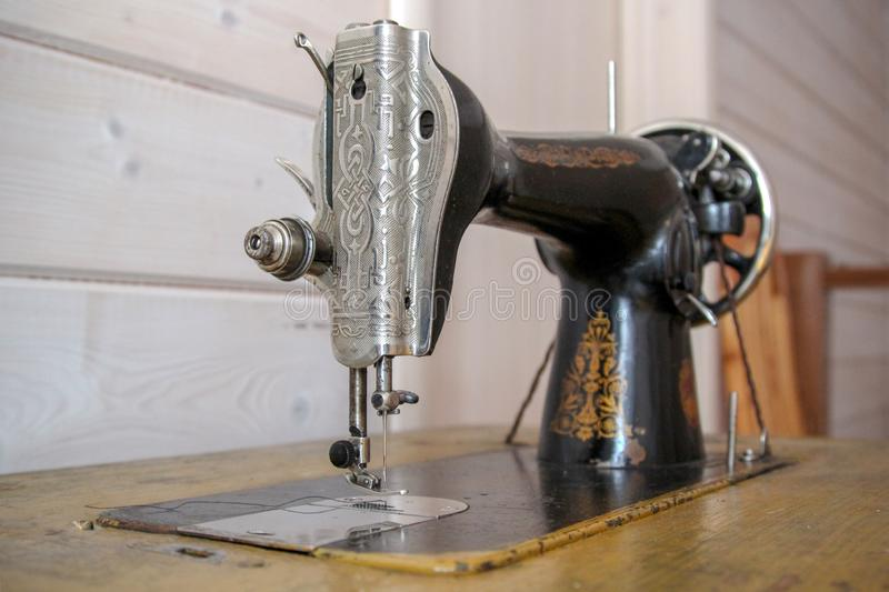 Beautiful retro sewing machine for textile design. Vintage light backdrop. Line art textile design stock photos