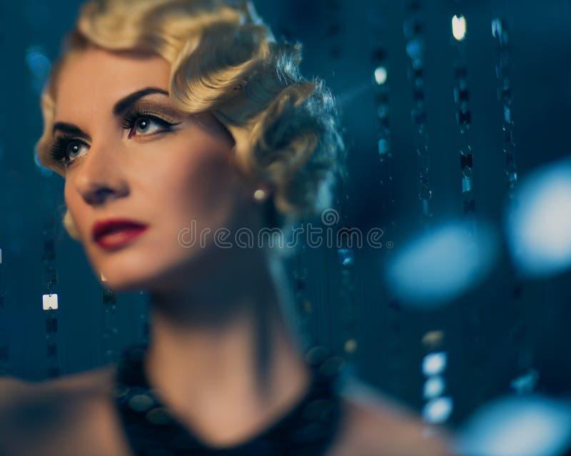 Beautiful retro woman. Elegant blond retro woman with beautiful hairdo and red lipstick royalty free stock photos