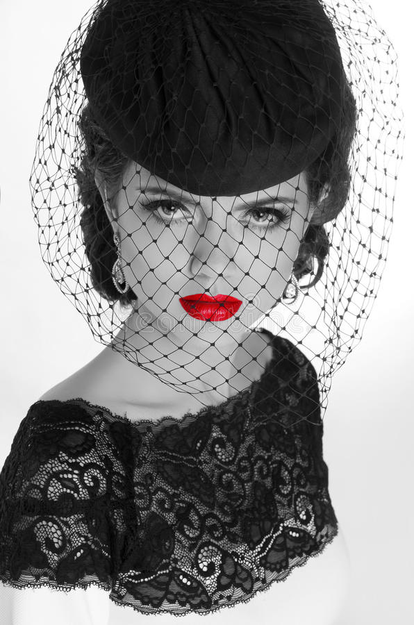 Beautiful retro woman portrait in elegant hat with red lips, beauty makeup. Black and white photo. stock photos