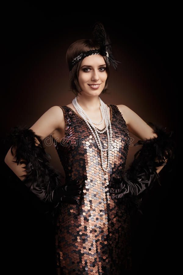 Beautiful retro woman from the roaring 20s ready to party royalty free stock photos