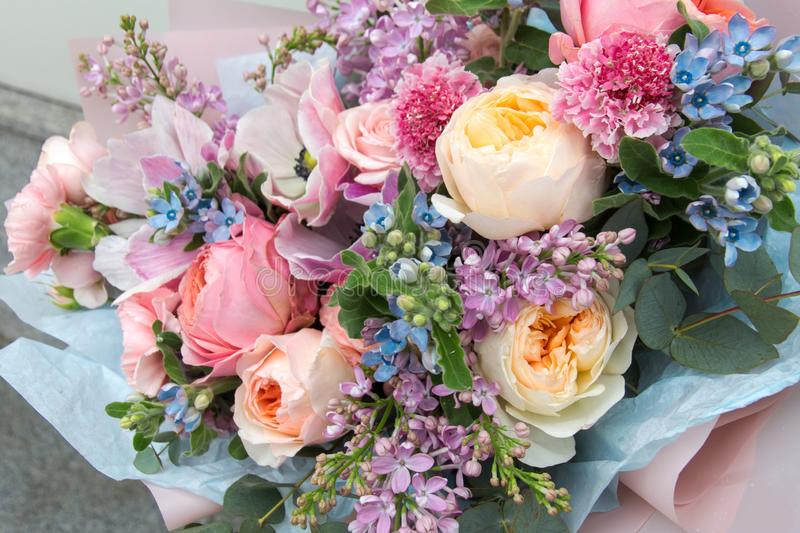 Beautiful wedding pink bouquet, flowers arrangement by florist with roses, lilac and blue flowers. Floral background stock images