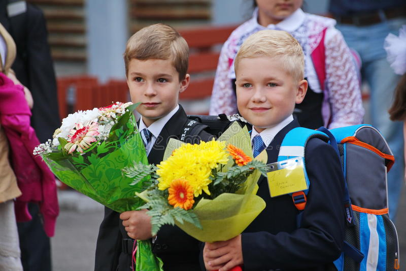 Beautiful, richly and solemnly dressed children with flowers at the school festival of knowledge royalty free stock photos