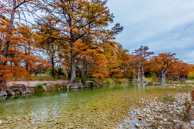Beautiful Rio River at Garner State Park, Texas. Beautiful Fall Foliage Surrounding the Clear Gravely Rocky Frio River, Texas stock photo