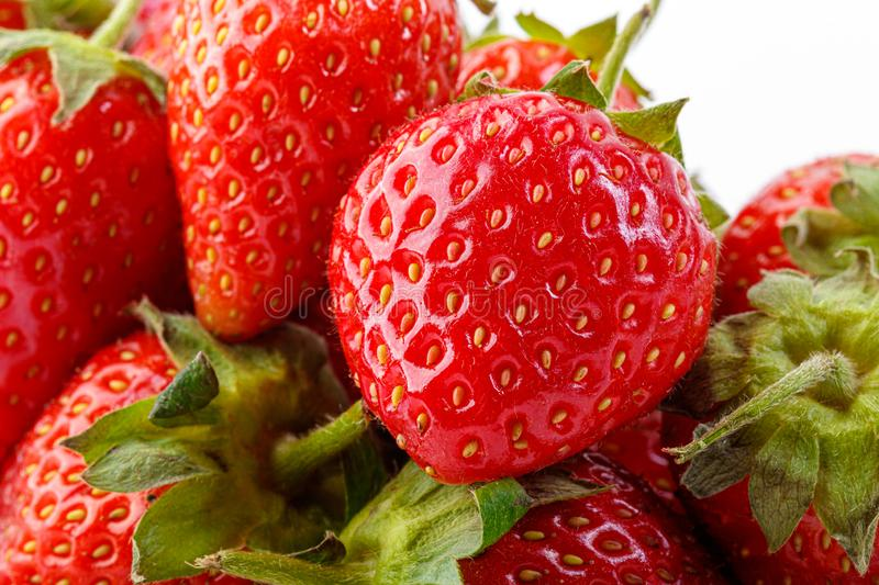 Beautiful and ripe red strawberries on a white background. Close up royalty free stock photo
