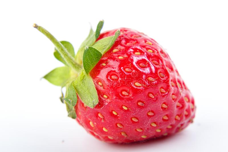 Beautiful and ripe red strawberries on a white background. Close up stock photography