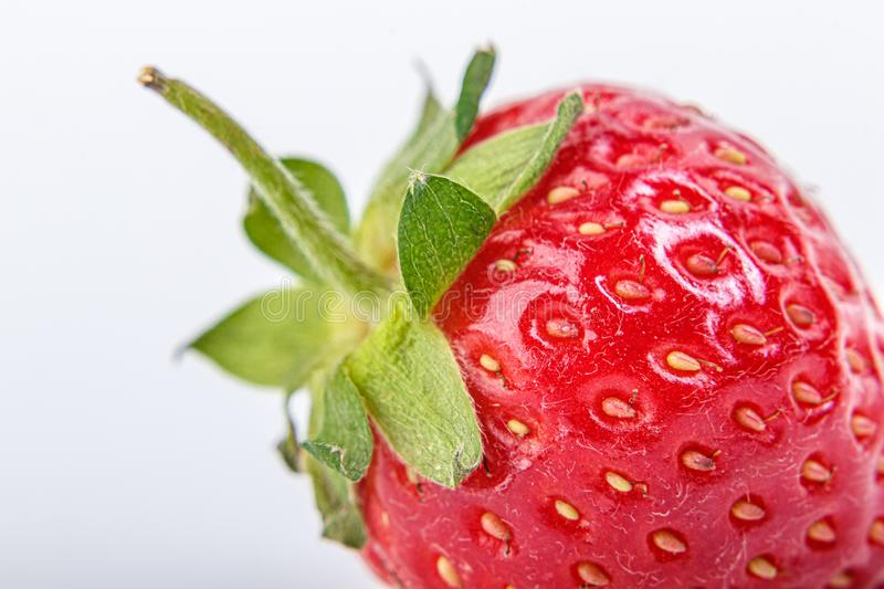 Beautiful and ripe red strawberries on a white background. Close up stock photos