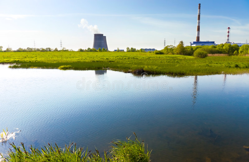 Beautiful river bank and power plant stock photography