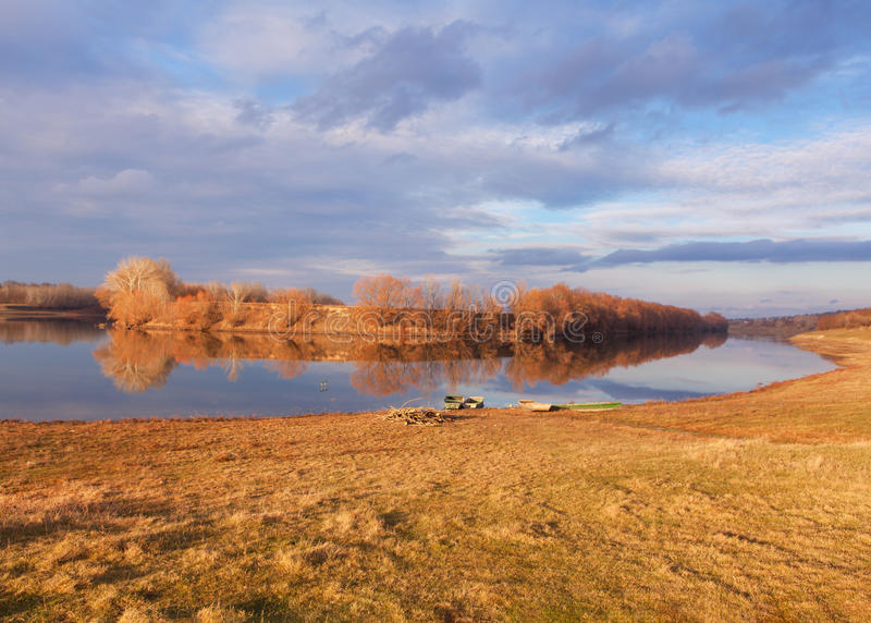 Beautiful river landscape. Late autumn landscape with old boats on the river royalty free stock photo