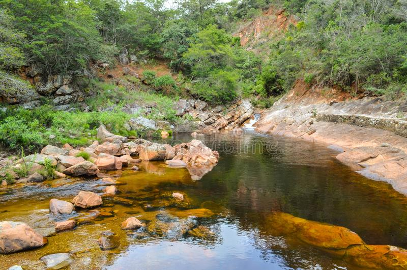 Beautiful river with canyons, waterfall, cascades, forest in a state park of Brazil. Beautiful river between a tropical forest at a state park in Brazil stock photos