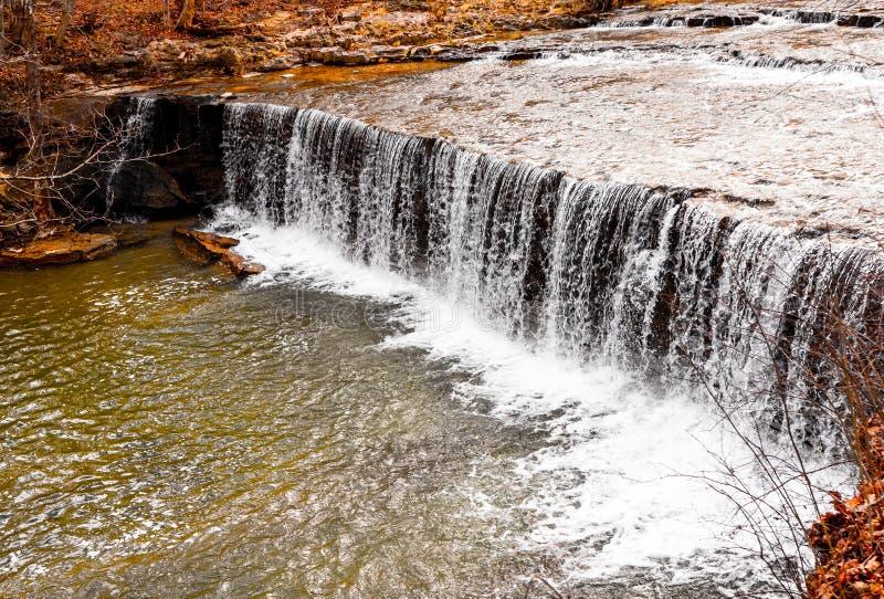 White water rapids waterfall crashing to the river floor. stock photos