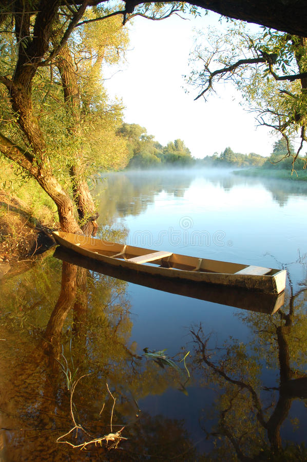 Beautiful river and yellow boat stock images