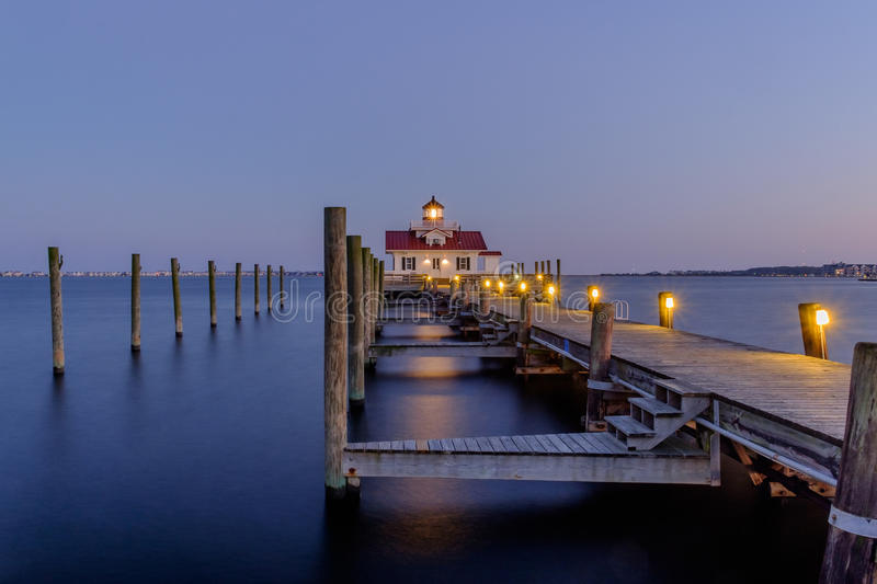 The Beautiful Roanoke Marsh Lighthouse located on the Outer Bank. S of North Carolina at sunset stock image