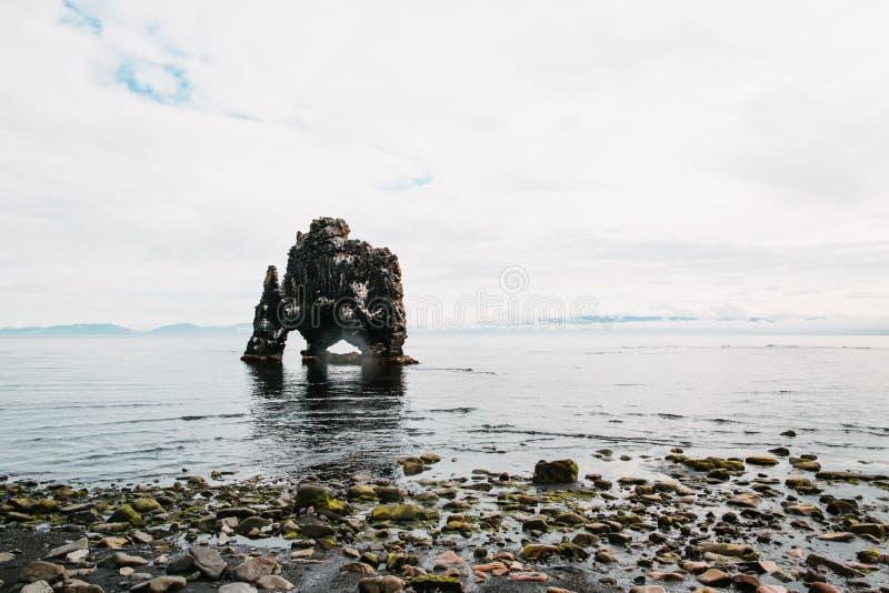 Beautiful rock formation in water near icelandic seacoast,. Hvitserkur, iceland stock photos