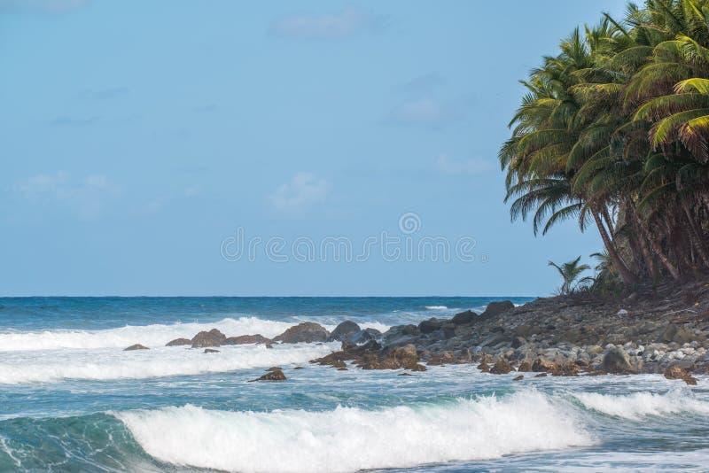 Beautiful rocky Dominica shoreline taken before Hurricane Maria destruction stock photo