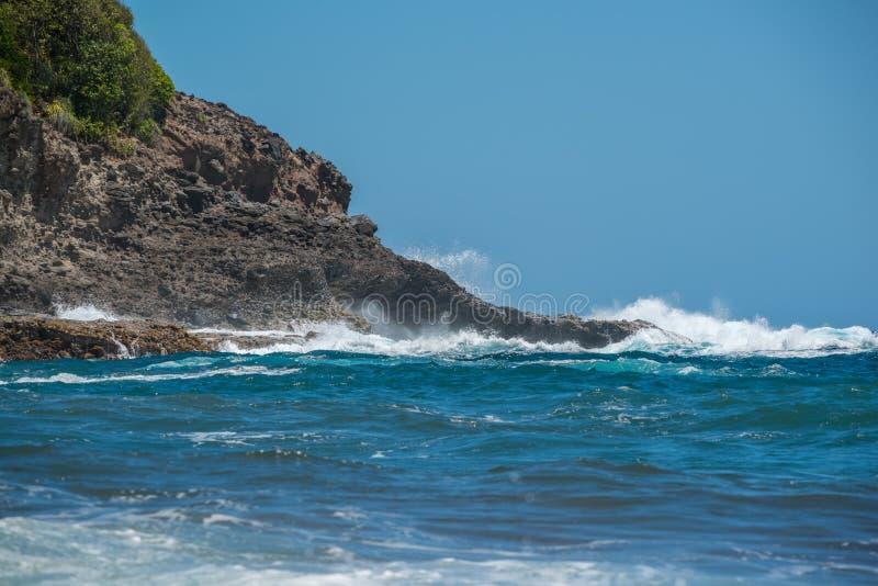 Beautiful rocky Dominica shoreline taken before Hurricane Maria destruction.  royalty free stock photo