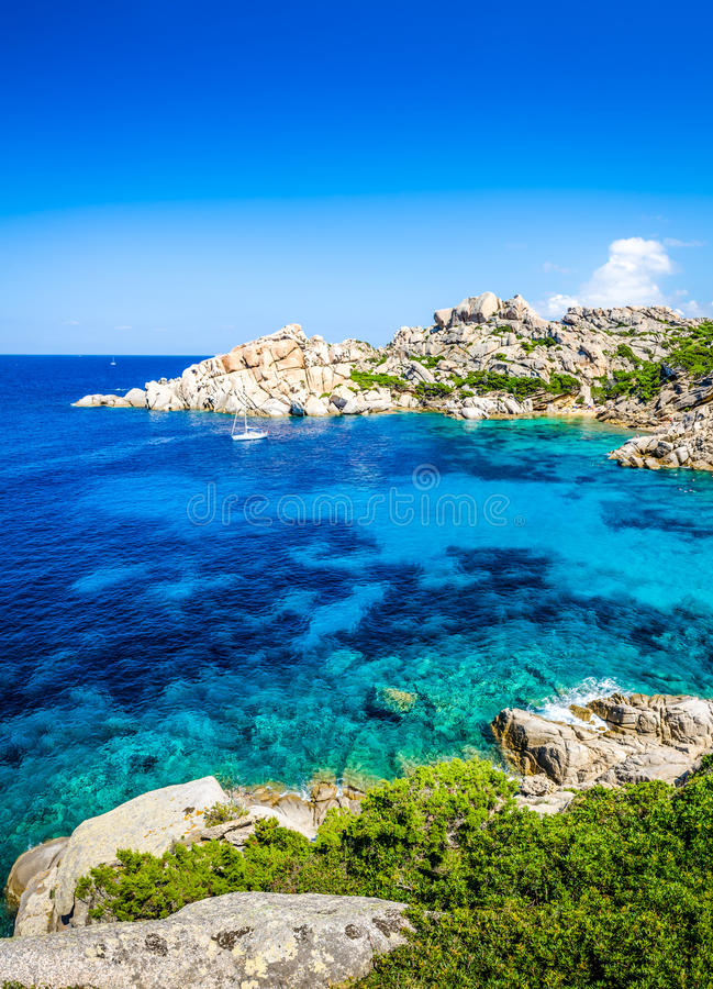 Beautiful rocky ocean bay with turqouise water royalty free stock images