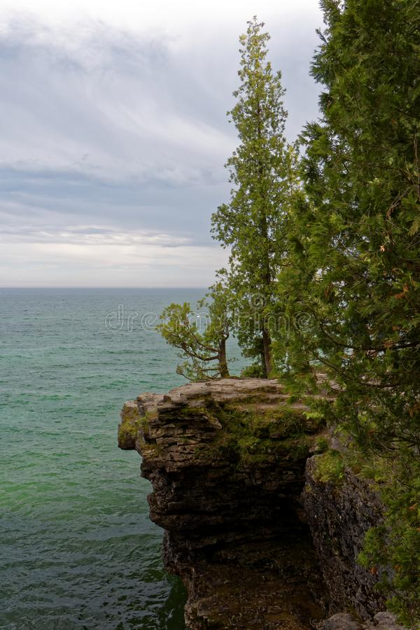 The rocky shoreline of Lake Michigan in Wisconsin. The beautiful rocky outcroppings along the shore of Lake Michigan stock image