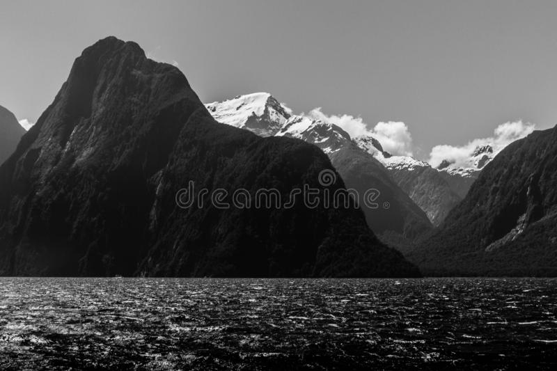 Beautiful rocky and snowy mountains at Milford Sound, New Zealand royalty free stock image