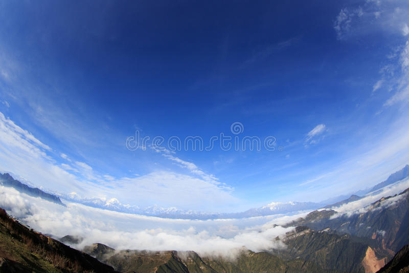 Beautiful rolling clouds and snow mountain royalty free stock image