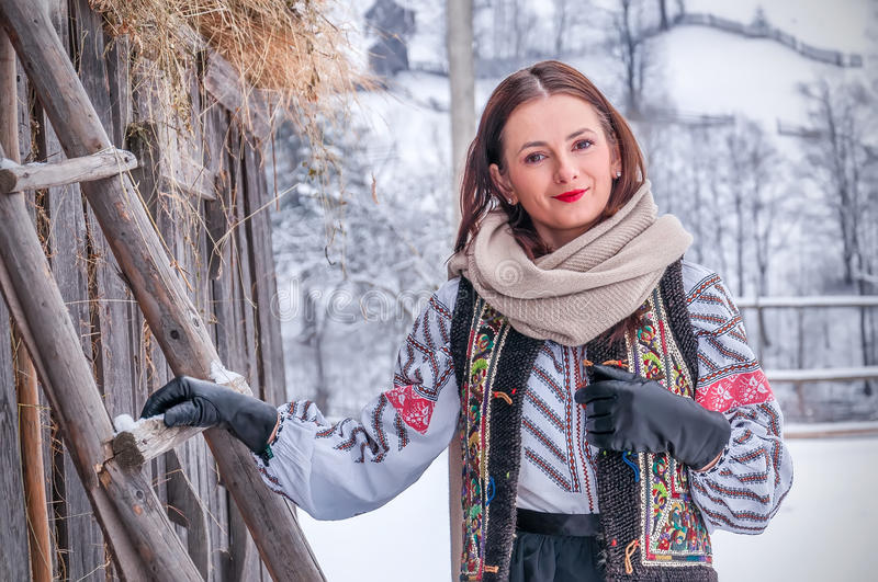 Beautiful romanian girl in traditional costume royalty free stock images