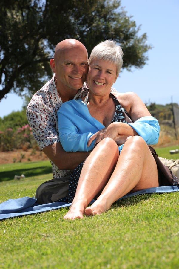 Beautiful romantic couple. Beautiful mature couple relaxing outdoors stock photo