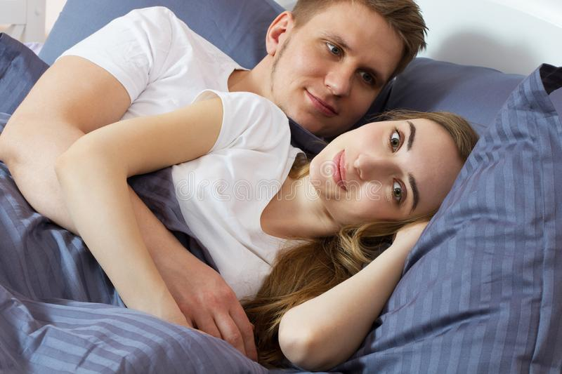 Beautiful romantic couple in bed, happy relationship, heterosexual couple.  stock images