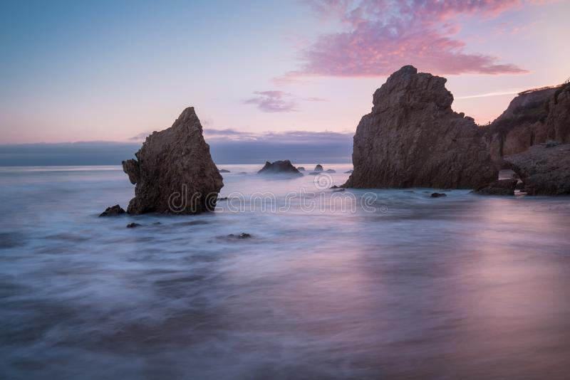 Beautiful and romantic El Matador State Beach in Malibu, Southern California, USA. Sunset in California - waves and sun. Hitting these beautiful rock formations royalty free stock photos