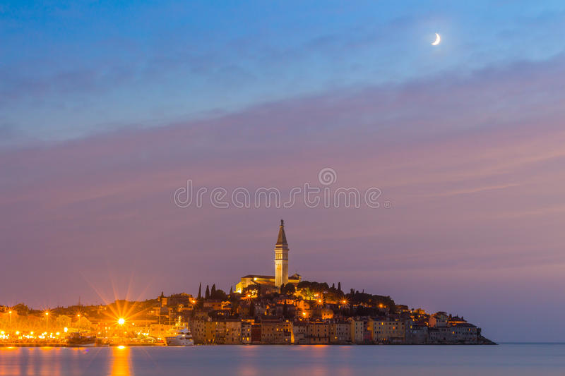 Beautiful romantic old town of Rovinj after magical sunset and moon on the sky,Istrian Peninsula,Croatia,Europe royalty free stock photography