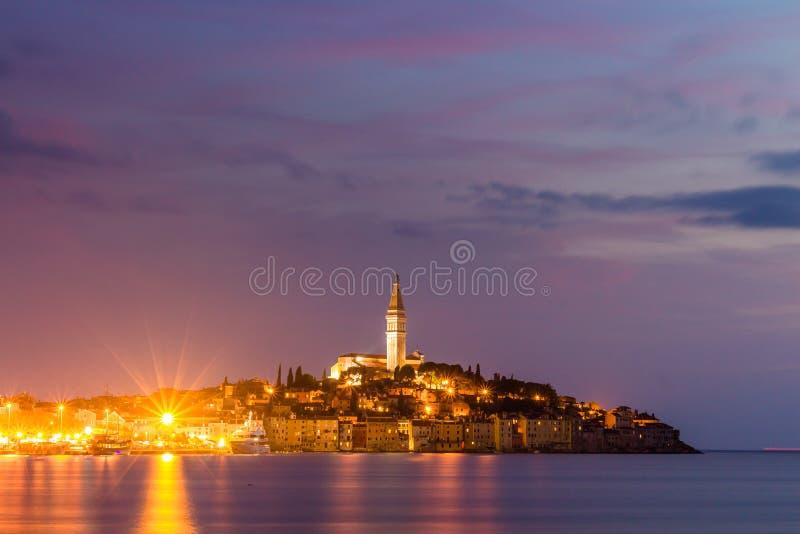 Beautiful romantic old town of Rovinj after magical sunset and moon on the sky,Istrian Peninsula,Croatia,Europe stock photos