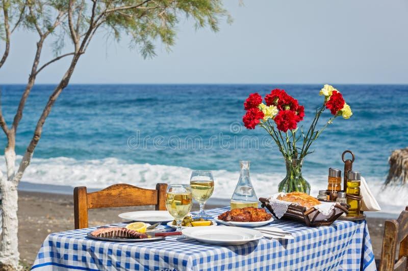 Beautiful romantic table on the beach royalty free stock photos
