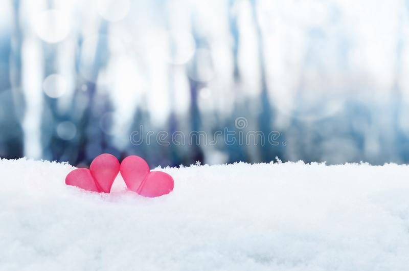 Beautiful romantic vintage red hearts together on white snow winter . Love and St. Valentines Day concept stock image