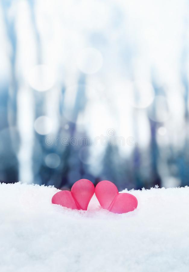 Beautiful romantic vintage red hearts together on white snow winter . Love and St. Valentines Day concept stock photography