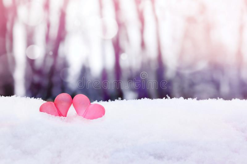 Beautiful romantic vintage red hearts together on white snow winter . Love and St. Valentines Day concept royalty free stock image