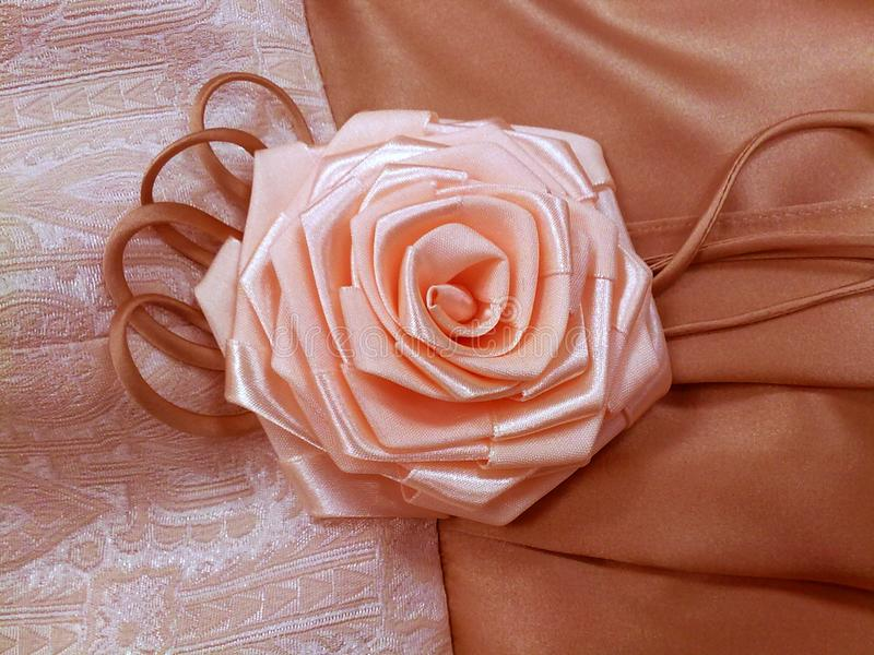 Beautiful rose handmade flower of ribbons garment element decoration stock image