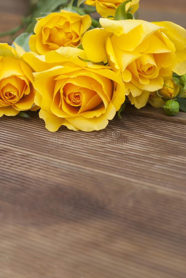 Beautiful Roses Bouquet over Wooden Table. Copy Space. Vintage yeelow flowers. Vertical image. royalty free stock photography