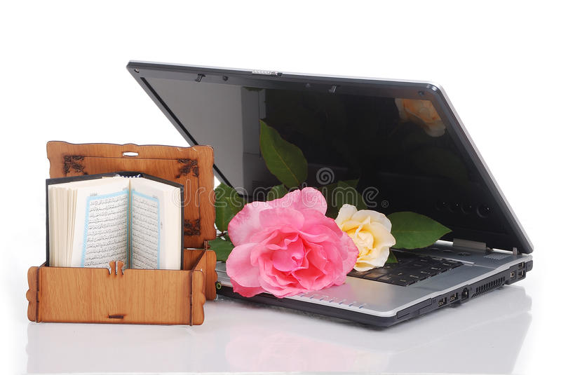 Download Beautiful Roses Laptop And Islam Holy Book Put T Stock Photo - Image: 10747270