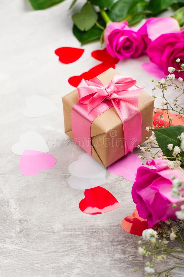 Beautiful roses on wooden background. Valentines day or mothers day greeting card stock photo