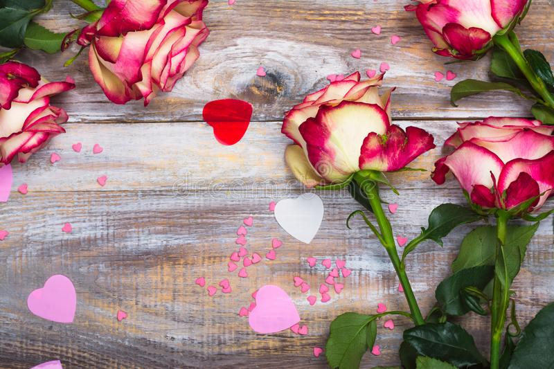 Beautiful roses on wooden background. Valentines day or mothers day greeting card royalty free stock images