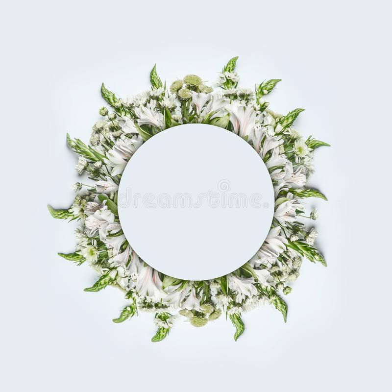 Beautiful round circle floral frame or wreath layout with green flowers on white background royalty free stock photo
