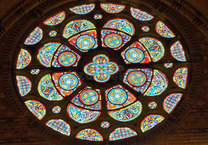 Beautiful round ornamented glass stained window. Detail of a church window royalty free stock image