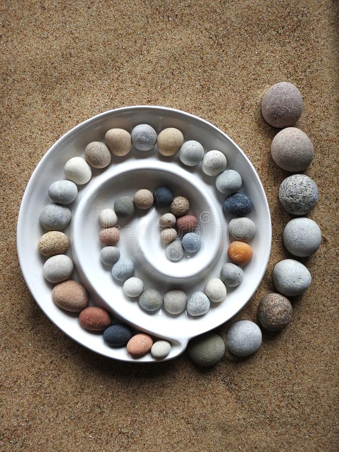 Beautiful round stones on sea sand, Lithuania royalty free stock photography