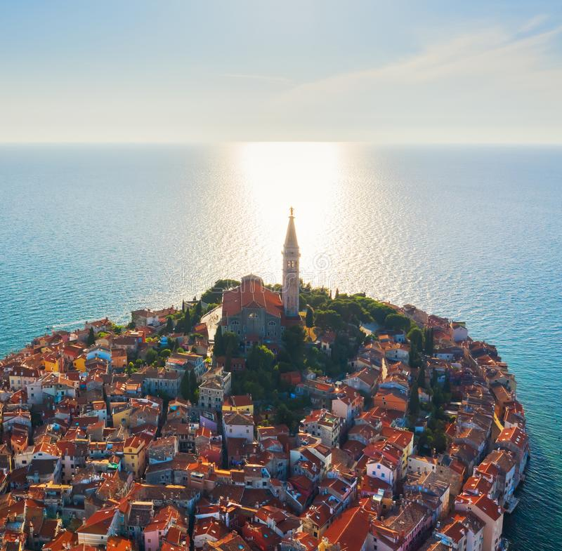 Beautiful Rovinj at sunset. Evening aerial photo of the old town of Rovinj with church of St. Euphemia, Istria, Croatia royalty free stock photos